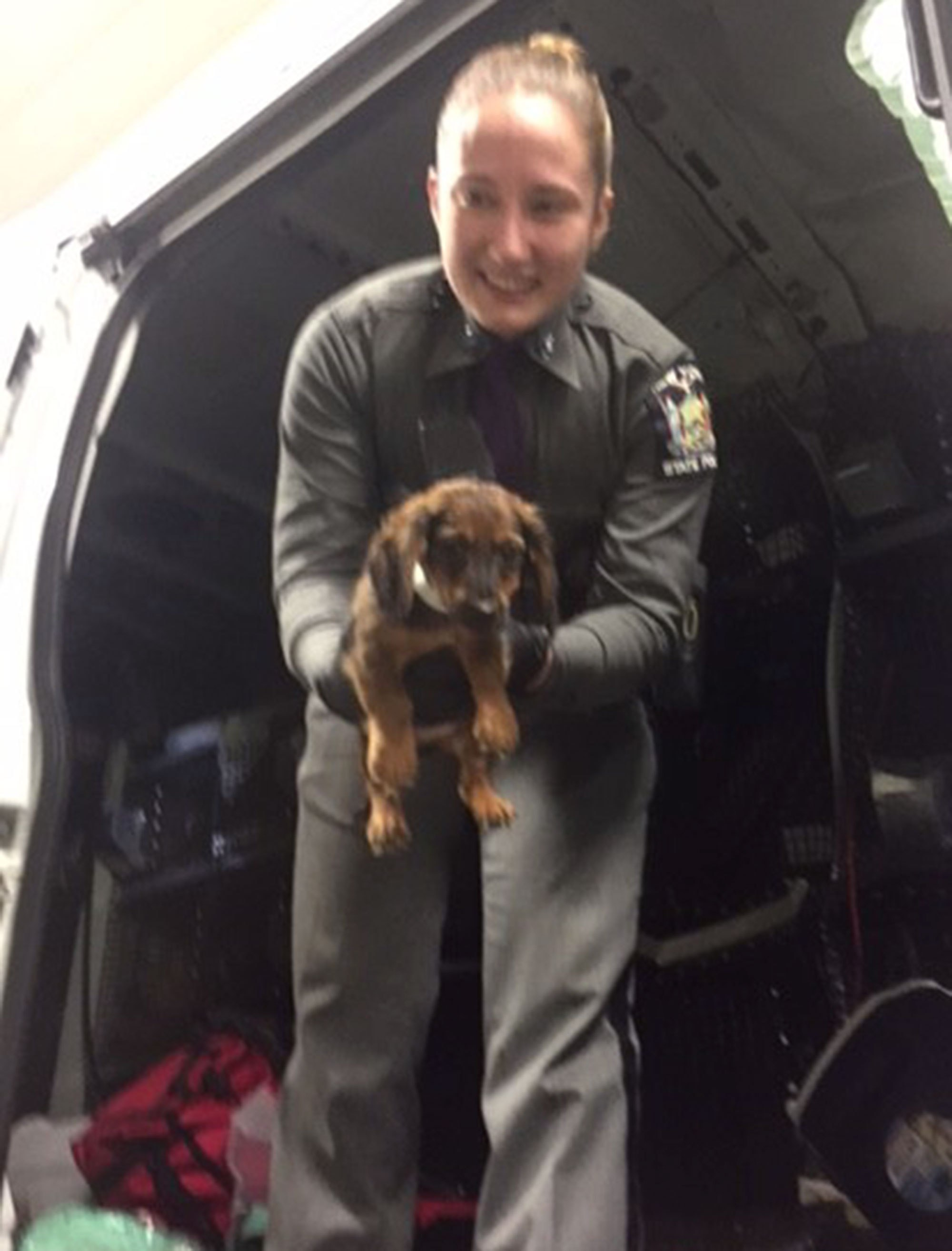 New York State Troopers with rescued puppies