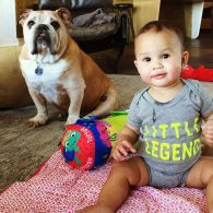 Baby Luna and her bulldog