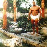 Mike Tyson poses with his tiger