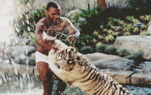 Mike Tyson wrestles his tiger