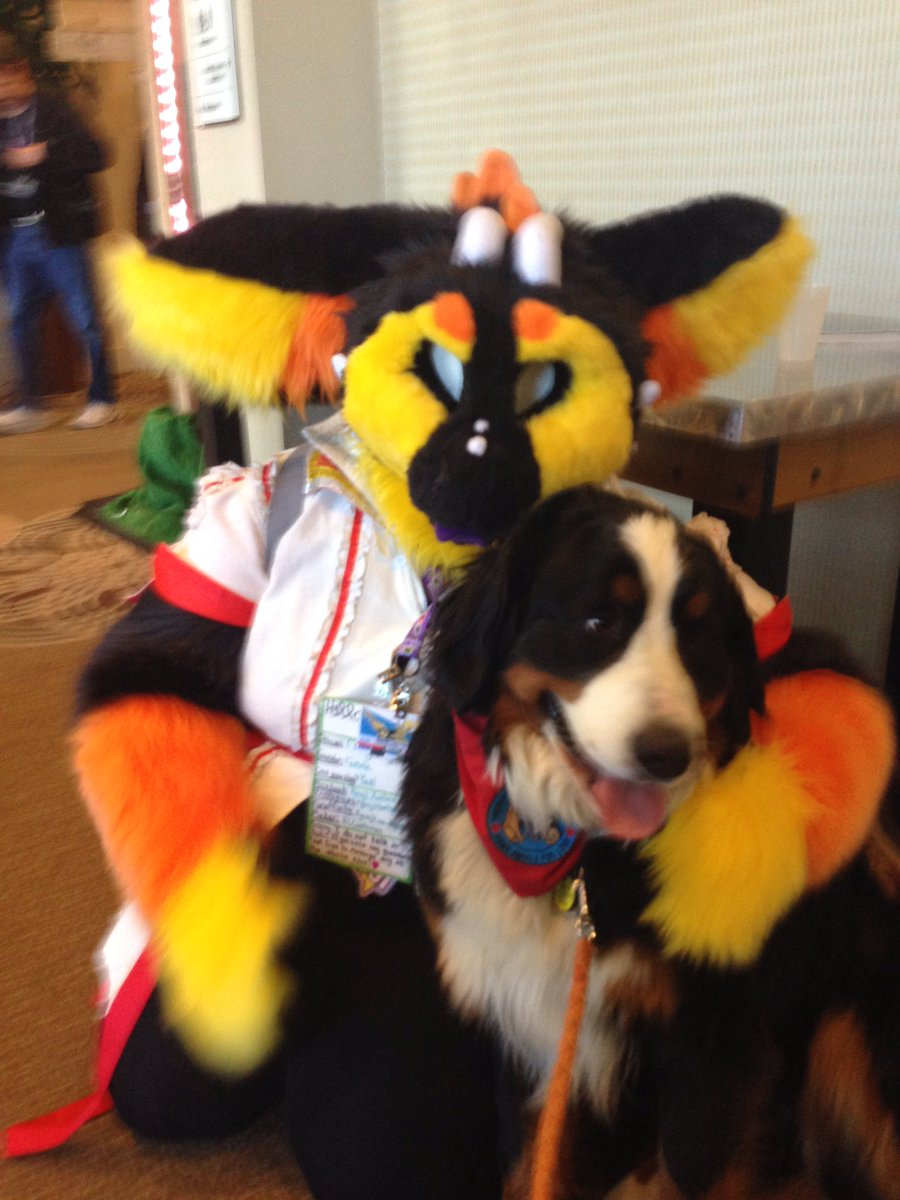 Woman brings her dog to a Furry Convention