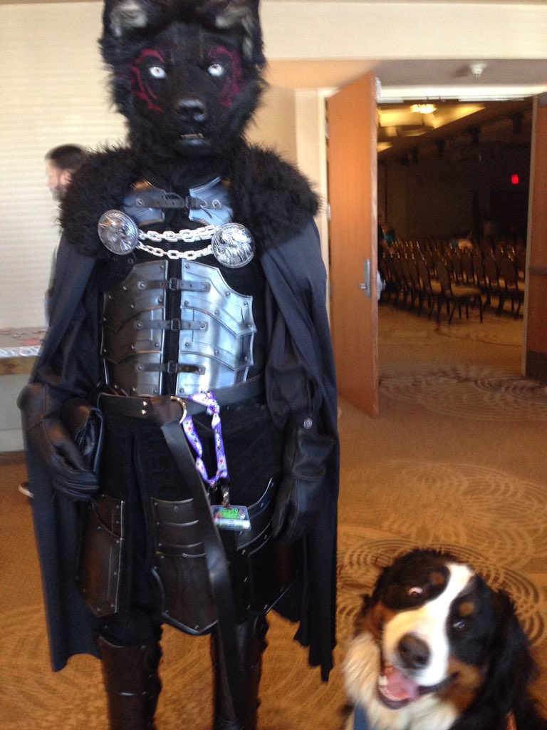 Woman brings her dog to a Furry Conventio