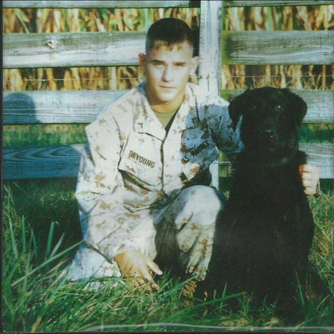 Marine Jeff DeYoung and Cena bomb sniffing dog